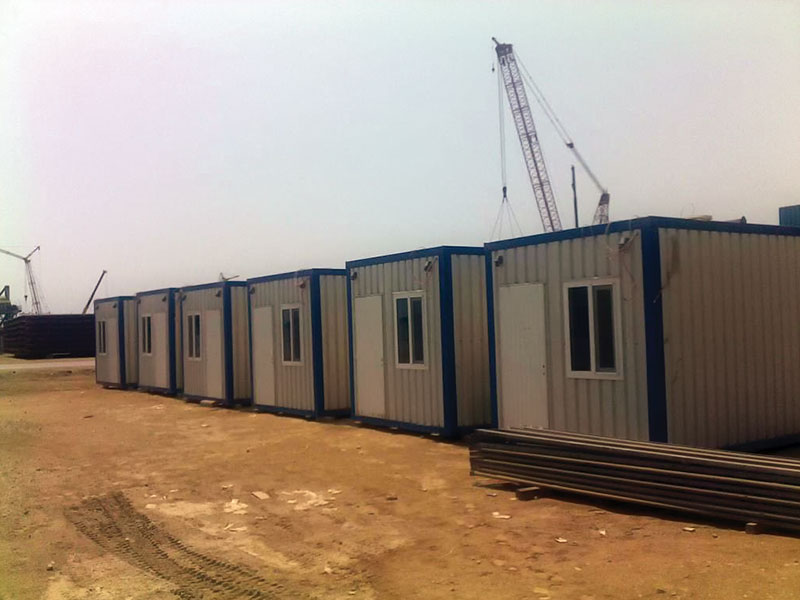 Phase I : Procurement & erection of 10 nos onshore cabins,  Phase II: Procurement & erection of 12 nos onshore cabins and 32 nos offshore cabins including furniture, stairs and roof structure etc.
